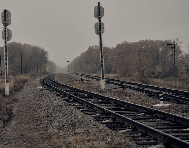 Railroad tracks against clear sky