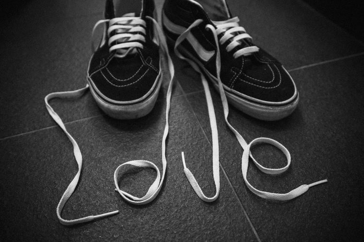 Love text with shoelace on floor