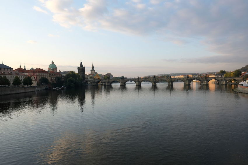 view on the famous charles bridge in prague Autumn colors Classic Architecture Czech Republic Historical Building My Best Travel Photo Prague Prague Czech Republic Sightseeing Arch Bridge Architecture Bridge Bridge - Man Made Structure Building Exterior Built Structure Charlesbridge City Cloud - Sky Connection Nature No People Prague Old Town River Sky Sunset Transportation Travel Travel Destination Travel Destinations Water Waterfront
