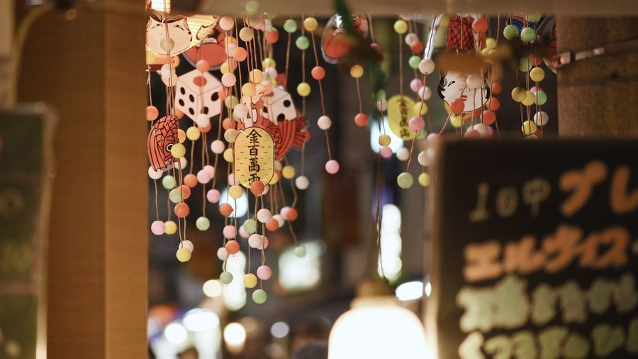 Hanging Choice Variation No People Text Decoration Selective Focus Focus On Foreground Multi Colored Retail  For Sale Close-up Indoors  Illuminated Large Group Of Objects Communication Group Small Business Retail Display Western Script