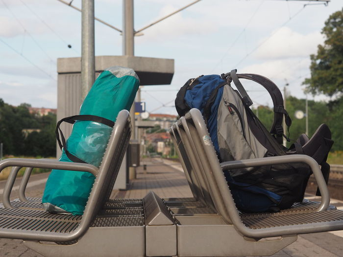 Close-Up Of Bags Left Unattended On Benches In Train Station Platform