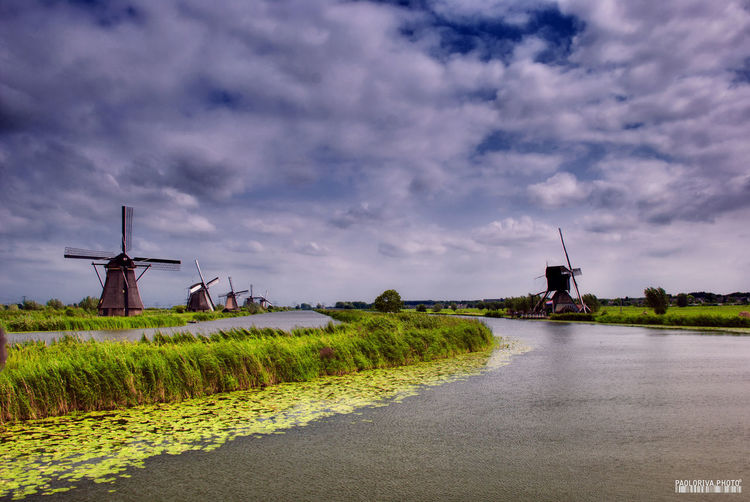 Architecture Beauty In Nature Built Structure Canal Cloud - Sky Environment Kinderdijk Landscape Nature No People Olanda Plant Rural Scene Sky Traditional Windmill Turbine Water Wind Power Wind Turbine