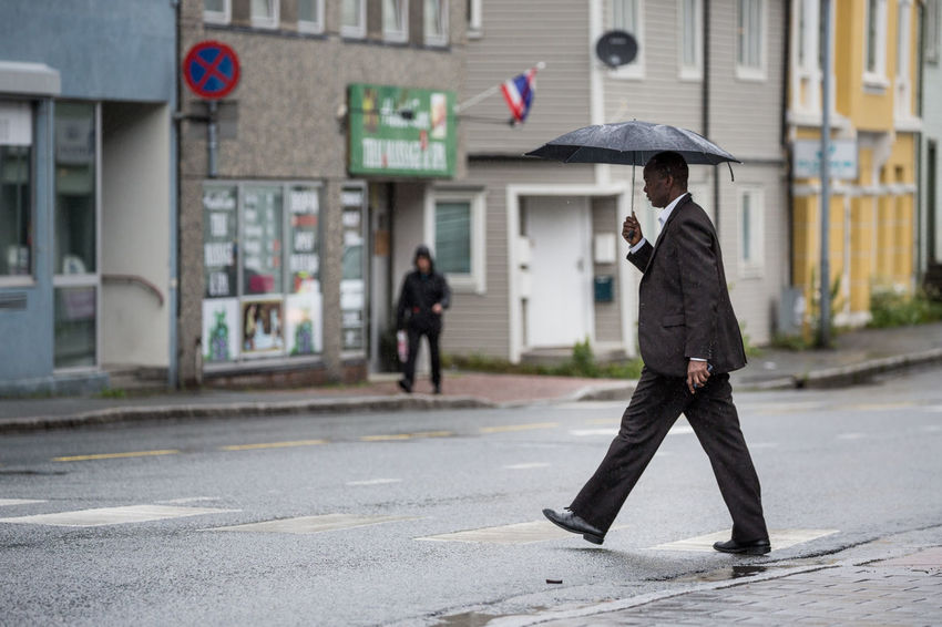 Architecture Bad Weather Built Structure Casual Clothing City City Life City Street Crossing The Street Day Focus On Foreground Full Length Leisure Activity Lifestyles Northern Norway Norway One Person Outdoors Rain Raining Rainy Days Road The Street Photographer - 2017 EyeEm Awards Umbrella Weather