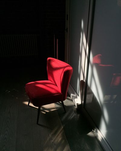 Empty chair on table by window at home
