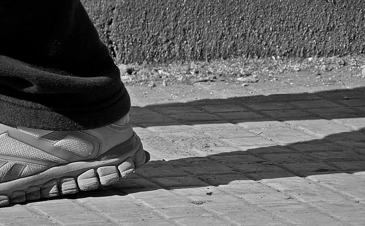 low section, real people, human leg, human body part, lifestyles, one person, day, leisure activity, shoe, men, outdoors, women, close-up, adult, people