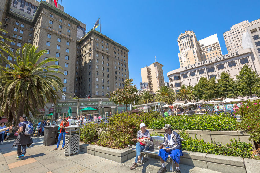 San Francisco, CA, United States - August 17, 2016: crowds of tourists in the popular Union Square, the central square of San Francisco on Market Street, known as the place shopping and luxury hotels. San Francisco, California, United States - August 17, 2016: the Big Bus, Hop On Hop Off, Sightseeing Tour, the popular double-decker bus carrying tourists, standing in Union Square, during a day tour. Cable Car California Market SF San Francisco Square Union Union Square SF United States Adult Architecture Blue Building Exterior Built Structure City City Life Clear Sky Day Large Group Of People Market Street San Francisco Market Street Men Outdoors Palm Tree People Real People Sky Skyscraper Street Sunlight Togetherness Tree Union Square  Unionsquare Walking Women