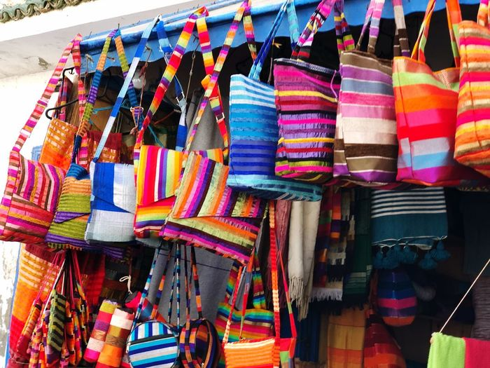Multi colored bags hanging at market stall