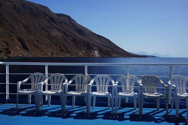 Blue Boat Chairs Crete Day Ferry Leisure Mediterranean Sea Mountain No People Outdoors Row Scenics Seven Tourism Travel Traveling Vacations Water