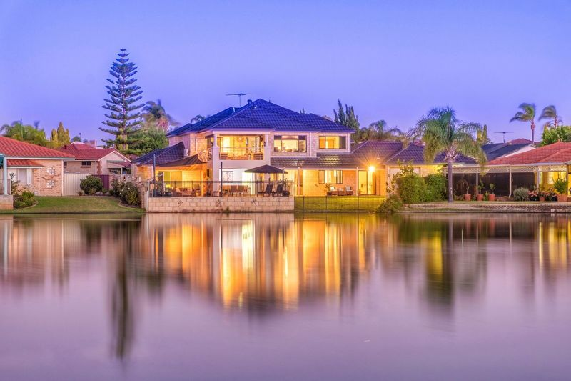 Beautiful Canal home in Ballajurah Perth Western Australia Lake Water Reflection Waterfront Outdoors Built Structure Architecture Nature Clear Sky Building Exterior Tree No People Illuminated Sky Day