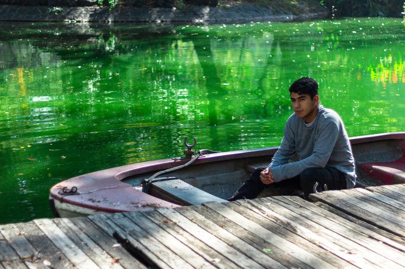Man sitting in boat on lake