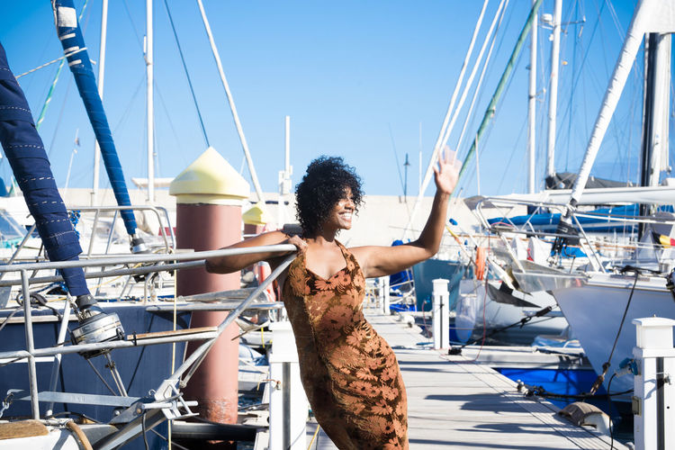 Smiling woman standing at harbor