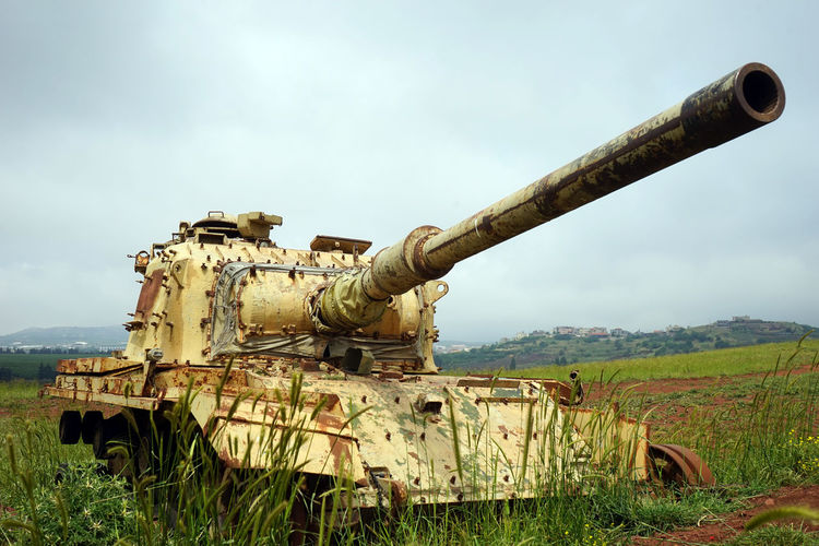 Sky Tank Field Weapon Day Abandoned No People Nature Military Land Damaged Plant Obsolete Armored Tank Metal Cannon Rusty Old Outdoors History Deterioration Battle