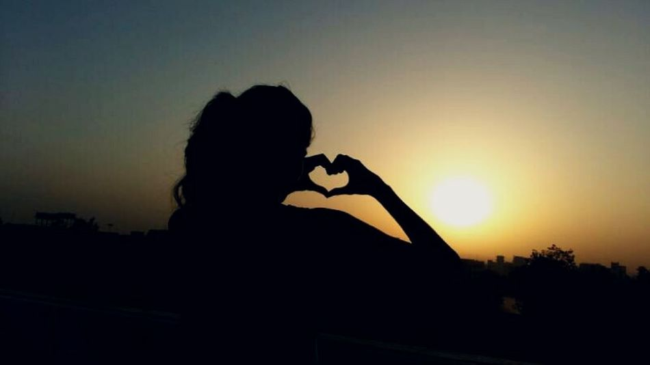 Silhouette One Person Adults Only Photographing Adult One Woman Only Sunset One Young Woman Only Nature Outdoors Sky Day Only Women Beauty In Nature Vacations Landscape Sunlight And Shadow Heart With Hands Hearts