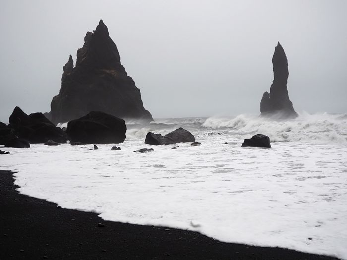 Iceland Volcanic  Black Sand Beach Volcanic Landscape Sea Beach Water Rock Land Sky Beauty In Nature Nature Solid Scenics - Nature Rock - Object Rock Formation Tranquility Tranquil Scene Day No People Non-urban Scene Idyllic Horizon Over Water Outdoors