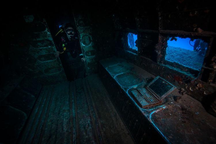 Scuba Diver Exploring Shipwreck