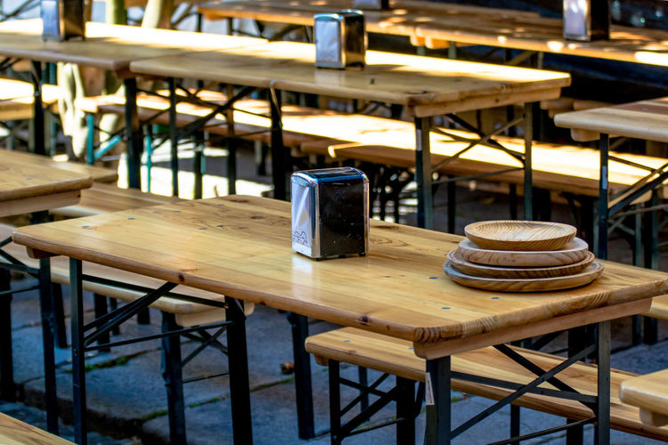 Absence Arrangement Chair Close-up Day Empty Focus On Foreground Furniture Napkins No People Outdoors Place Setting Plates Restaurant Seat Selective Focus Still Life Street Photography Table Traditional Wood Wood - Material Wooden