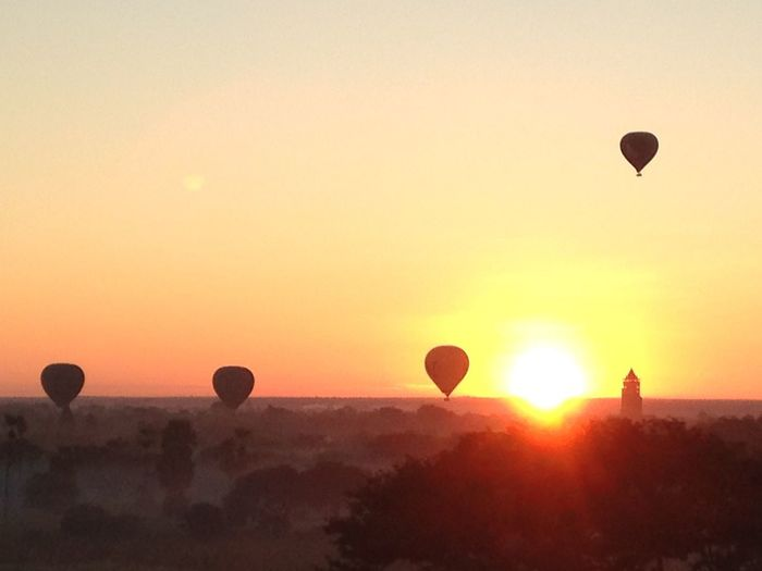 Hot air balloon flying in sky during sunset