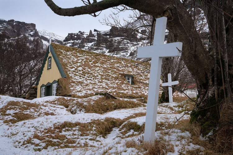 Hofskirkja, Iceland Tree Plant No People Nature Day Outdoors Hof Iceland Europe Church Chapel Religion Built Structure Building Exterior Building Place Of Worship Place Of Interest Landmark Travel Destinations Travel Tourism Tourist Attraction  Cross Old Rural Scene Village Winter Wintertime Snow Sightseeing