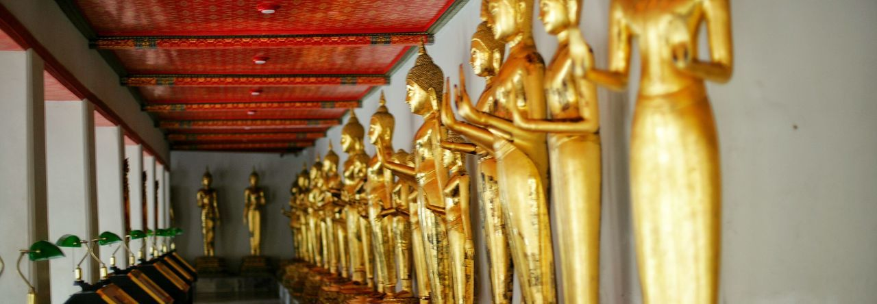 Architectural Feature Art Art And Craft Creativity Cropped Day Gilded Gold Colored Golden In A Row Indoors  No People Place Of Worship Religion Repetition Spirituality Statue Temple - Building