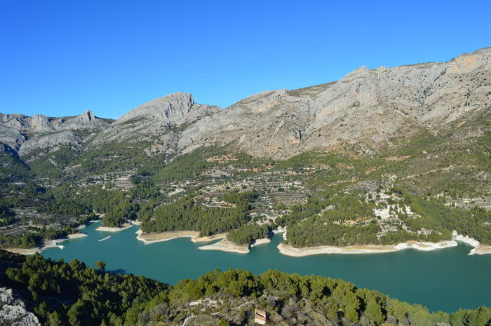 Guadalest Guadalest SPAIN Travel Destinations Lake Nature Panoramic Panoramic Photography Outdoors Tree Water Mountain Clear Sky Blue Forest Pinaceae Lake Rock - Object Pine Tree
