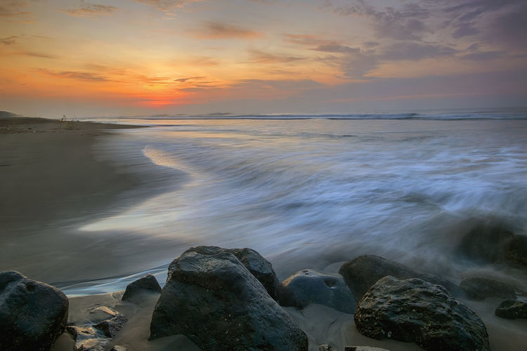 sunrise, waves and rocks INDONESIA Beach Beauty In Nature Central Java Cloud - Sky Horizon Horizon Over Water Idyllic Indonesia_photography Land Motion Nature No People Outdoors Rock Rock - Object Rocky Coastline Scenics - Nature Sea Sky Solid Sunset Tranquil Scene Tranquility Water