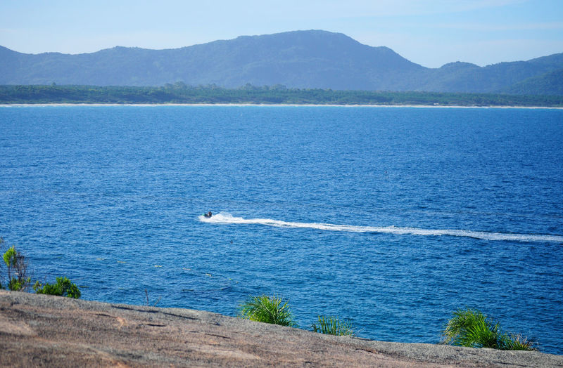Ocean View Jet Ski Water Mountain Tree Lake Blue Landscape Mountain Range Calm