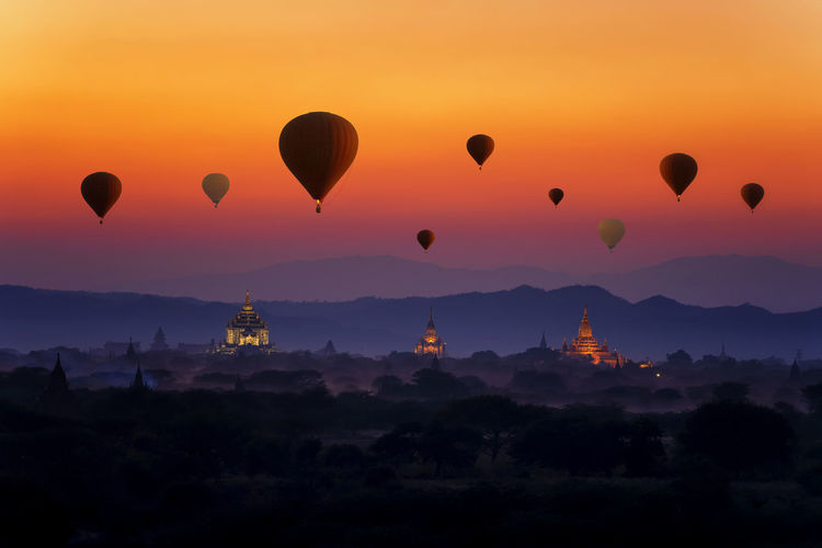 Sunset many hot air balloon with stupas in bagan, myanmar. space for text. nyaung-u, myanmar.