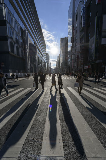 Adult Adults Only Architecture Building Exterior Built Structure City City Life City Street Day Ginza Large Group Of People Men Only Men Outdoors People Police Force Real People Road Shadow Shadows Sky Street Street Photography Sunlight The Way Forward