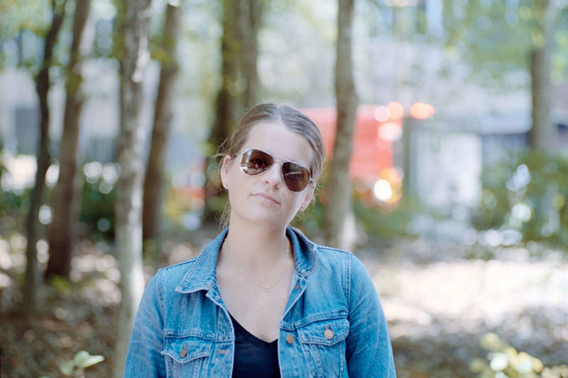 Portrait of young woman in sunglasses at forest