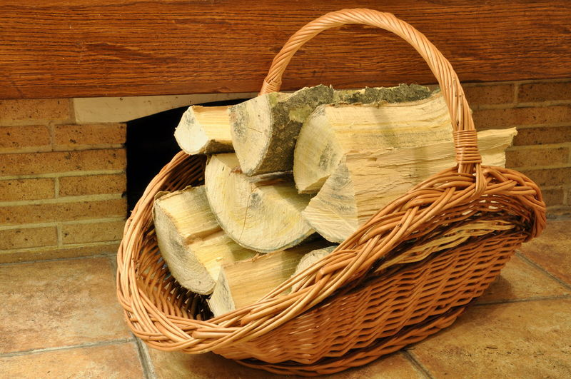 Firewood in a wicker basket in front of the fireplace Autumn Burning Winter Autumn🍁🍁🍁 Basket Container Ecology Energy Fireplace Firewood Fuel And Power Generation Heat Heating Log No People Pile Still Life Warm Warm Clothing Wicker Wood Wood - Material