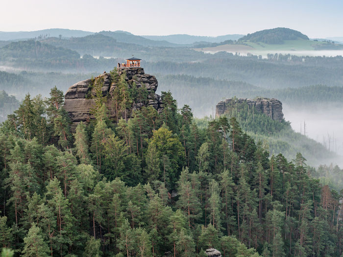 Breakfast during dawn in gazebo on mariina rock. morning panorama, bohemia switzerland park, czechia