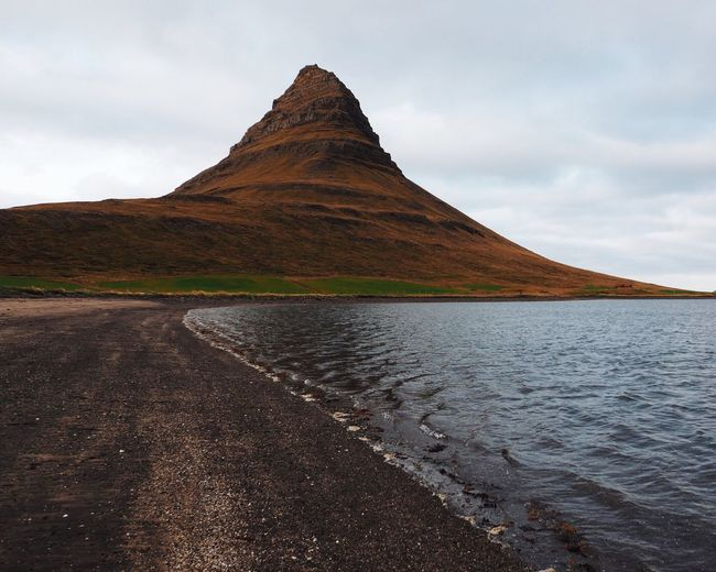 Nature Scenics Beauty In Nature Water Outdoors Tranquility Landscape No People Mountain Cloud - Sky From My Point Of View at Kirkjufell Iceland My Year My View Miles Away The Great Outdoors - 2017 EyeEm Awards