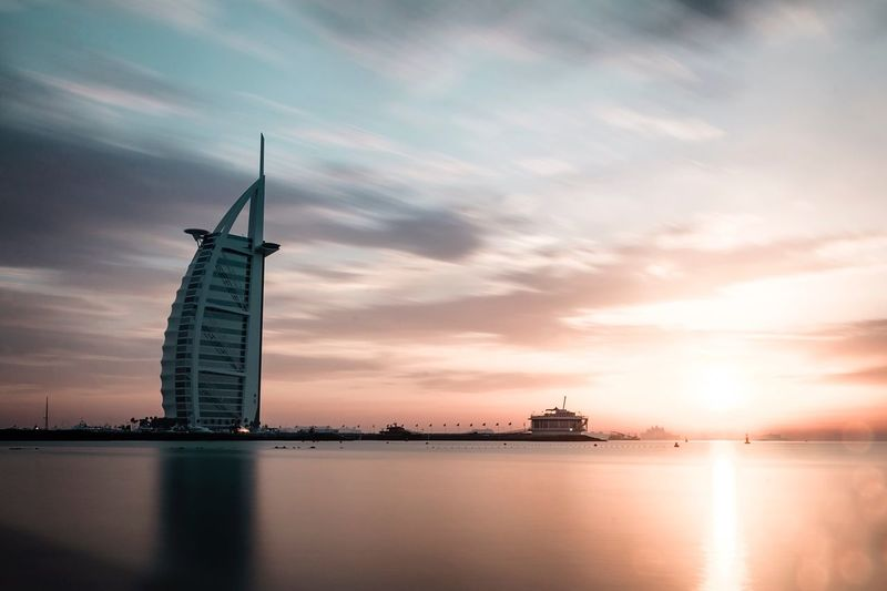 Sunset Water Sky No People Cloud - Sky Waterfront Sea Nature Built Structure Nautical Vessel Beauty In Nature Architecture Outdoors Windmill Day Dubai