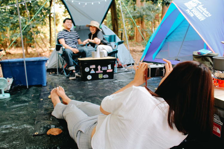 Rear view of people sitting in tent