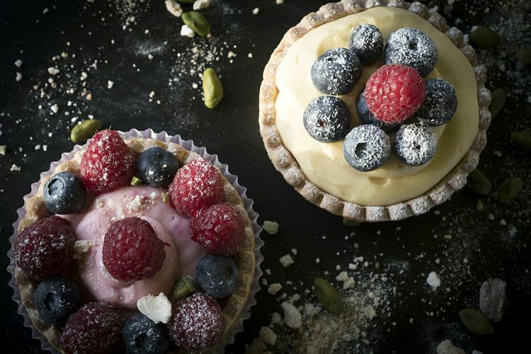 High Angle View Of Fruit Tarts On Table