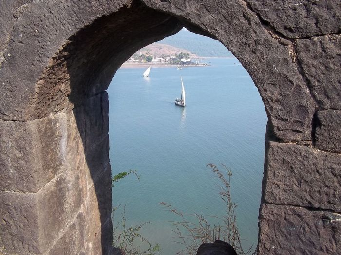 Yacht Seen On Sea Through Arch