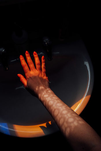 High angle view of hands at home