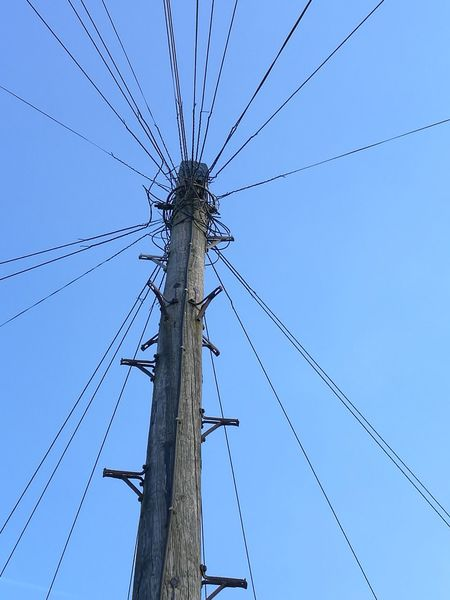 Pole Suburbia Blue Sky Cable Low Angle View Blue No People Outdoors Sky Day Telephone Line