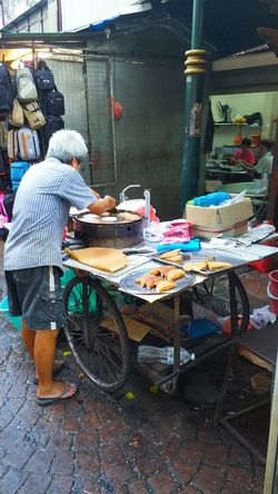 China town Malaysia Kuala Lumpur Chinatown Streetfood Hungry Food Desserts Apam Balik Pancake #Wanderlust #travel #travelphotography Foodphotography Yummy Snack Time! Wanderlust Shops Travel Photography Real People One Person Day Outdoors Working Adult People