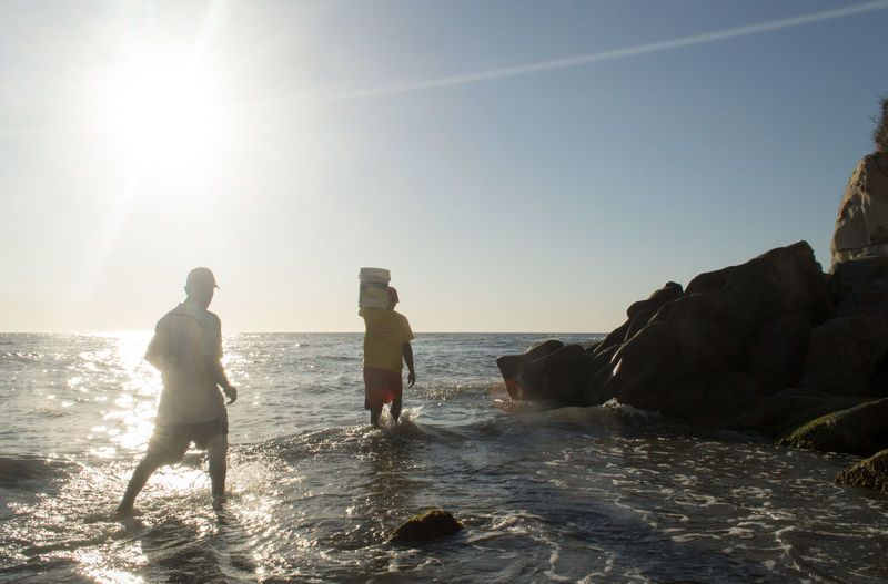 Beach Bonding Colombia Colombia ♥  Connection Day Friendship Horizon Over Water Leisure Activity Outdoors People Santa Marta, Colombia Sea Sky Standing Togetherness Travel Destinations Two People Vacations Water