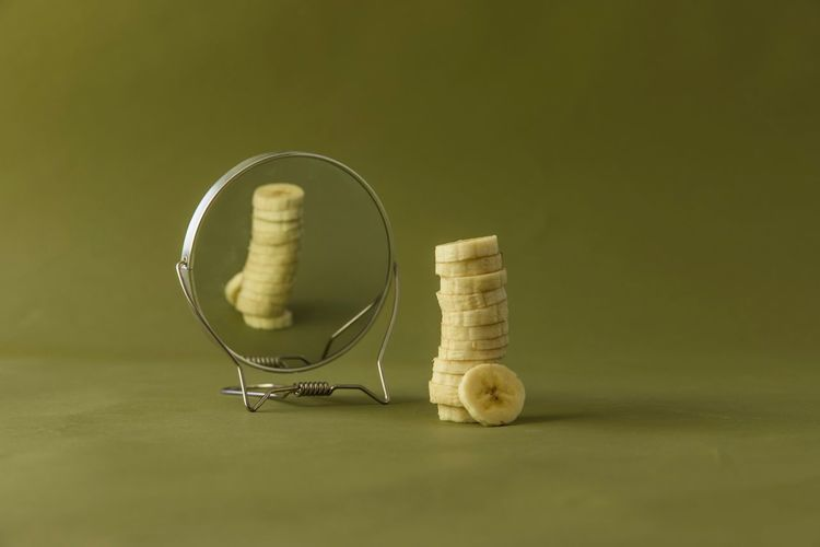 Slices Of Banana With Reflection On Mirror