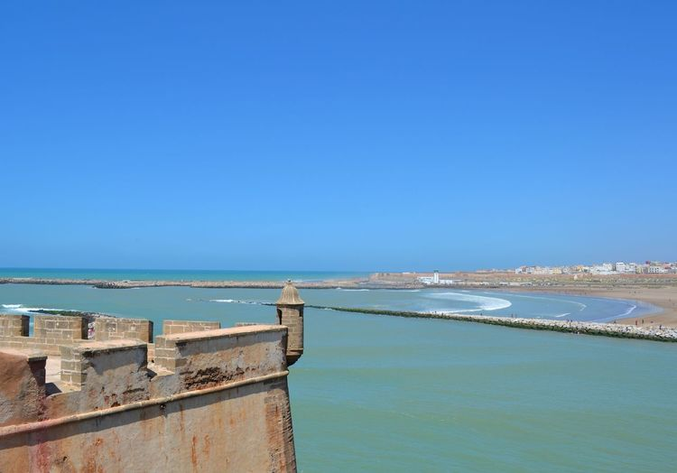 A beautiful beach overlooking Sale in Rabat Morocco, 2013 Land Nature Day Outdoors Beach Rabat Rabat Morocco Old Castle 2013 Water Sea Sky Blue Clear Sky Scenics - Nature Copy Space Architecture No People Tranquil Scene Beauty In Nature Tranquility