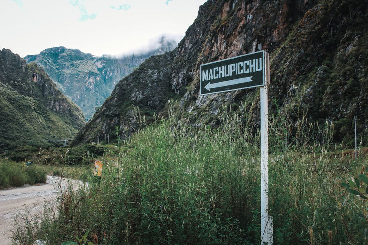 The way to Machu Picchu! Hiking Latin America Machu Picchu Adventure Beauty In Nature Communication Day Guidance Information Sign Landscape Mountain Mountain Range Nature No People Non-urban Scene Outdoors Plant Road Salkantay Scenics - Nature Sign South America Text Travel Destinations Western Script