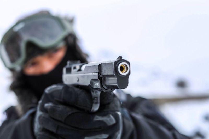 Close-Up Of Man Aiming Gun
