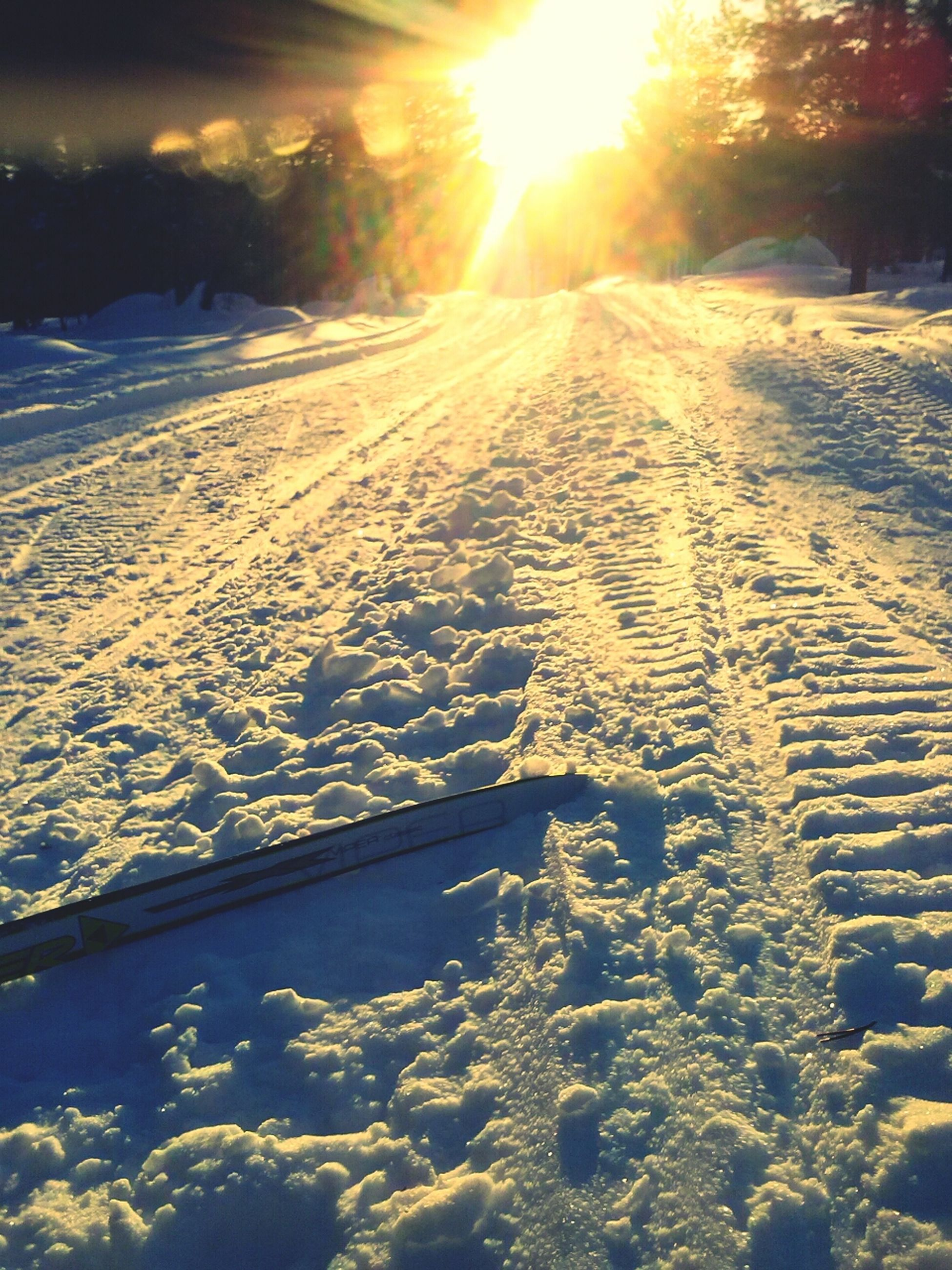 snow, winter, cold temperature, sun, season, sunlight, transportation, sunbeam, nature, tranquility, covering, tranquil scene, lens flare, landscape, weather, beauty in nature, road, the way forward, scenics, frozen