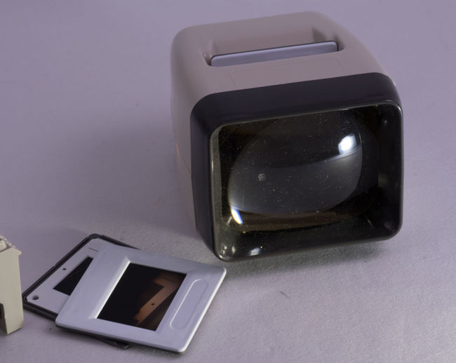 """EyeEm suggested the tag """"toaster"""". It is a simple device to watch slides in daylight without using a projector and screen. Old Technology Close-up Day Indoors  Low Tech No People Slides Slideshow Studio Shot Table Technology Wireless Technology"""