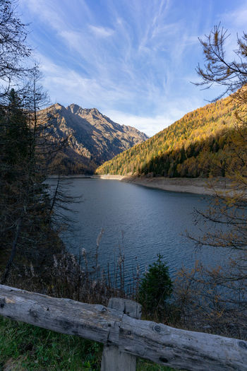Lago di Pian Palù Water Sky Mountain Beauty In Nature Lake Scenics - Nature Plant Tranquility Tranquil Scene Tree Nature No People Day Cloud - Sky Non-urban Scene Outdoors Barrier Mountain Range Remote Fall Fall Beauty Fall Colors Autumn Autumn colors