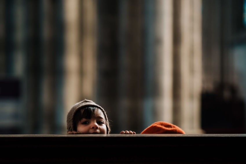 PEEK A BOO Church Body Part Child Childhood Contemplation Emotion Focus On Foreground Front View Girls Headshot Indoors  Innocence Lifestyles Looking Looking Away Offspring One Person Portrait Real People Twodayscologne Women