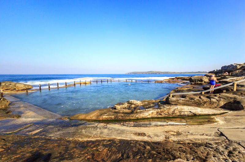 Mahon Rock Pool from a distance Swimming Beach Beauty In Nature Blue Clear Sky Day Horizon Over Water Mahon Pool Men Nature One Person Outdoors People Pool Rock Pools Sand Scenics Sea Sky Swimming Pool Travel Destinations Vacations Water