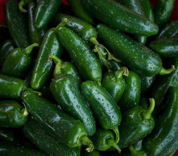 Full frame shot of wet green chili peppers